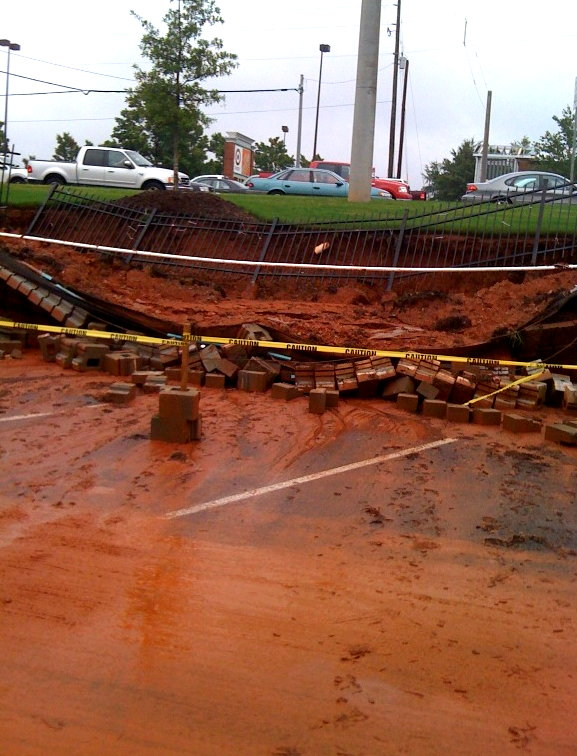 My pic of a collapsed retaining wall at a strip mall in suburban Atlanta