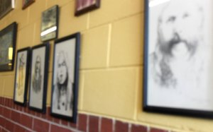 Portraits of Allman Brothers Band members are on the wall at the H&H Restaurant in Macon. (Credit: Steve Burns.)