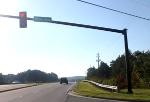 """A sign reading """" Scales Road"""" has been affixed at a Suwanee (Ga.) intersection. (Photo taken Sept. 6, 2014. Credit: Steve Burns.)"""