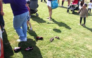 Shoes are left behind in the childrens' play zone at Suwanee Fest 2014. (Credit: Steve Burns.)